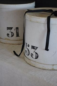must do this as a project...paint my old floral hat boxes with white chalk paint and then stencil my favorite numbers on them or stencil letters for what is contained in each box. then use clear wax to protect from chipping.