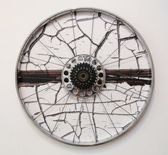 Sweet urban bike art! White weathered fence photograph framed in vintage steel bicycle wheel. On Etsy by Yvonne Bambrick in Toronto.