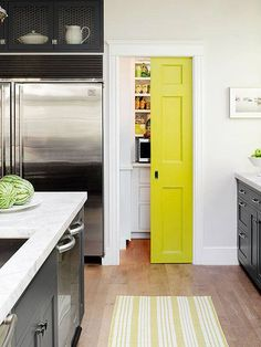Every home needs at least one chartreuse door. This clever pocket pantry door makes our point by serving as a fun focal point, adding much needed color to an otherwise monochromatic kitchen.