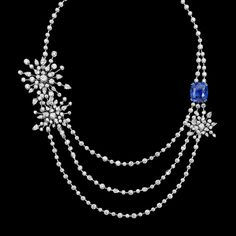 Limelight Garden Party necklace in 18K white gold, set with 248 brilliant-cut diamonds (approx. 27.56 ct), 27 pear-cut diamonds (approx. 5.33 ct) and a cushion-cut blue sapphire (approx. 23.82 ct). - Piaget
