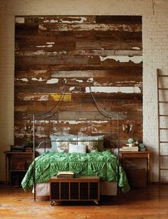 Seth Smoot, green bedspread, great bed frame, amazing wood wall against white brick