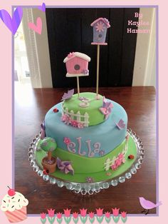 By Kaylee Haman, garden themed birthday cake with birdhouse, flowers, picket fence and pinwheels ;)