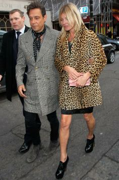 To celebrate her 40th birthday in London, style icon Kate Moss wore her favourite leopard print coat over a black lace dress and lace up heels.