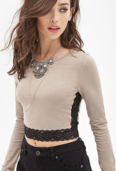 Buy it now. FOREVER21 Women's  Taupe & Black Lace Trim Crop Top. Style Deals - We love it when staples have updated accents that make them as on-trend as they are timeless - this top is a perfect example of that. With details like long sleeves, a shallow round neckline, and a stretch-knit fabric, it has all the features of our favorite basics. A cropped fit, complete with lingerie-inspired sheer lace trim and sides, are what take it to the next level. Lightweight94% cotton, 6% spandex15.5%22…