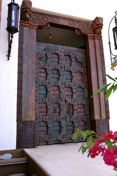 A beautiful ornate door found in Mexico on a residential home. This reminds me of the grand, huge door my grandmother had. It was handmade with wrought iron, ornate carvings on the wood, stained with beautiful colors and was 12 ft. high. It was a grand entrance to her beautiful hacienda!