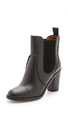 SLIP ON BOOTIES $84.38 Layered seams and suede-trimmed elastic gores streamline a pair of smooth leather Marc by Marc Jacobs booties, styled with a notched outsole and stacked heel. Leather sole.