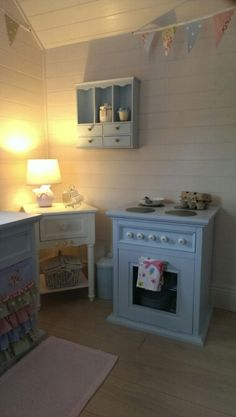Playhouse interior... Got the wall unit in tk maxx but repainted it to match. Love the mini trash can which is the perfect shade of blue.
