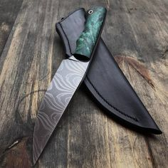 """Finished Recon with dyed buckeye and leather sheath. Easy twist 1095 and 15n20 blade. Knife is about 10"""" overall and will be available this evening at prickblades.com. #knife #knives #handmade #hunting #camping #outdoors #edc #leather #leathercraft #blade #bushcraft #survival #tactical #knifepics #knifemaker #metalart #chicago"""