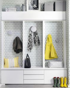 Bring a grey space to life by covering one corner or wall with a busily patterned paper in a tonal grey-green hue. Grey is smart and sophisticated, so stay on message with planned focal points and tight furniture arrangements, like this built-in storage unit.