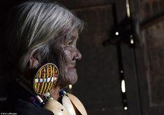 Burmese tribal beaded earrings and facial tattoos