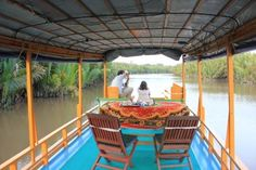 Upper deck of house boat, designed for exploring wildlife through the river on the forest