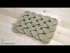 In this video I demonstrate how to make a rectangular rope mat. This one can work as a table mat under hot dishes or as a small door mat. The tutorial was inspired by The Ultimate Book of Decorative Knots, a book by Lindsey Philpott. A few useful tutori How To Braid Rope, Rope Knots, Macrame Knots, Nautical Rugs, Nautical Knots, Rope Crafts, Yarn Crafts, Small Door Mats, Rope Rug