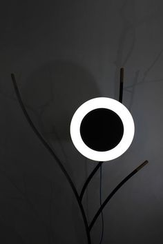 South Korean design studio Monocomplex took the inspiration for their latest lamp directly from a scene in nature. Appropriately named Scene #01, the lamp is reminiscent of a moon as viewed from behind the trees.