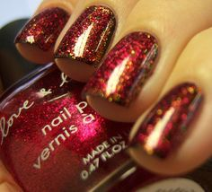 Sinful's Black on Black, and then added Sinful's All About You. Its an awesome gold, orange, rust colored glitter.  just to make it a tad more festive top it with a shear red or pink to let the glitter show through.