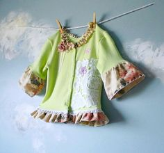 girls  upcycled cardigan...darling..easy to do something similiar...say to a sweatshirt