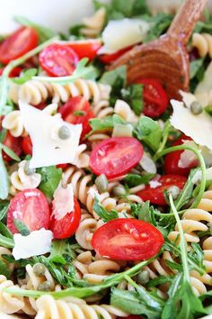 Simple Arugula Pasta Salad Recipe on http://twopeasandtheirpod.com The perfect salad for summer! It only takes 20 minutes to make and is a HIT at potlucks!