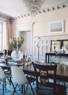 romantic dining room in pale peach and blue with gorgeous wood floors and dramatic chandelier | via coco kelley