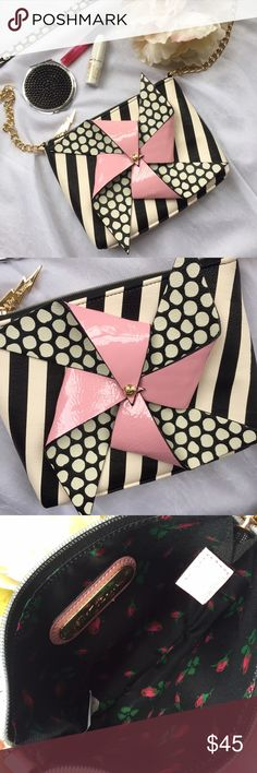 ✨HOST PICK✨ Betsey Johnson pinwheel crossbody This Betsey Johnson bag is so fun! Bag has gold chain with shoulder strap & top zipper but no inside pockets. Measures 8.5 x 6 inches. Brand new with tags and never worn. The pinwheel even spins! 🎉BEST IN BAGS PARTY HOST PICK 11.23.16🎉 Betsey Johnson Bags Crossbody Bags