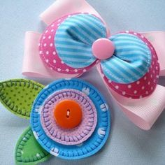 Bows made of felt and ribbon.  I love the bright colors.
