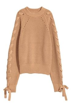 Jumper in a soft cotton-blend knit with hole-knit details, long raglan sleeves with lacing at the top and ribbing around the neckline, cuffs and hem.