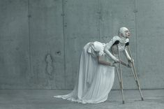 Evelyn Bencicova, Black and White Magic, surreal photo of multi-armed woman on crutches.