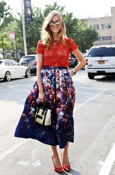 Shop this look on Lookastic:  https://lookastic.com/women/looks/crew-neck-t-shirt-midi-skirt-pumps-satchel-bag-watch/8922  — Red Lace Crew-neck T-shirt  — Silver Watch  — Navy Floral Midi Skirt  — Beige Leather Satchel Bag  — Red Satin Pumps