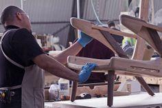 A master craftsman at work on a Hans Wegner Papa Bear Chair.