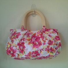 """Cute Floral Cotton Handbag Ready for spring? Strong and pale pinks, orange, pale yellow and black floral on a white background. Poppy colored interior. One zipper pocket inside. Snap closure on top. Light tone comfortable wood handles. Excellent-to-brand new condition. Strap drop 5.25"""". Great with your fave jeans, or that cute little dress you've been eyeing! Old Navy Bags"""