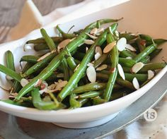 Bayou Bourbon Green Beans Recipe | Crisp-tender green beans get a sweet, smoky twist with hints of bourbon, brown sugar and almonds.
