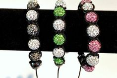 Shamballa bracelets $10   The grey and white one is perfect to wear in support of #braintumorawareness.  Grab the pink to support #breastcancerawareness