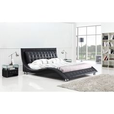 The curvy shape of the Dublin queen-size platform bed gives it a stylish appearance that improves your bedroom decor. Constructed of wood and leatherette, this solid piece of furniture is well-built and will keep you comfortable.