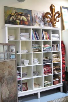 According to BRASWELL: Facelift for a IKEA Expedit Bookcase - adding legs and trim at top and bottom