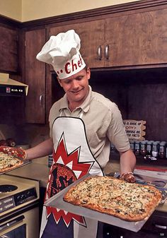 American astronaut Neil Armstrong, in an apron and hat labelled 'Chef' smiles as he uses oven mitts to up hold up a pair of pizzas in his Houston kitchen, March Photo: Ralph Morse, Time & Life Pictures/Getty Image / Time & Life Pictures Donald Pleasence, Anthony Kiedis, Reservoir Dogs, Chevy Chase, Neil Armstrong, Sarah Michelle Gellar, Stephen Hawking, Donald Trump, Apollo Space Program