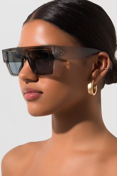 Time to slay. The AKIRA LABEL Doin Time Oversized Sunglasses feature a glossy plastic frame, aviator style design, connected top bar, subtle nose rest, and sleek temple handles that sit behind the ear. This sunnies go well with a badass attitude. Stylish Sunglasses, Oversized Sunglasses, Cat Eye Sunglasses, Sunglasses Women, Nice Sunglasses, Sunglasses Storage, Vintage Sunglasses, Sunglass Frames, Akira