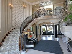 John Fogerty's Beverly Hills manison; The former CCR frontman's estate sits on on three acres along a gated cul-de-sac, and boasts nine bedrooms spread over 16,000 square feet, plus a two-story great room, a wine room, a library, a home theater, a four-car garage and a one-bedroom guest house.