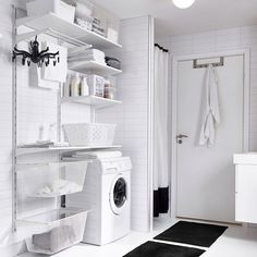 Laundry room ideas with white wall shelves, boxes in different sizes and a drying rack