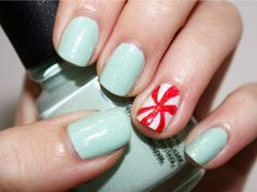 Minty fresh.1. Start with a base coat. 2. Once dry, apply two coats of a mint green nail polish 3. Apply two coats of white nail polish on your ring fingernail. 4. Using a red nail art pen, create the peppermint swirl. 5. Finish with a top coat.