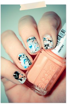 paint the base color, and then cover up your fingers, and splatter other nail polishes all over. Remove the cover.