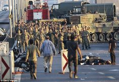 Groups of soldiers involved in the coup attempt in Turkey surrender on Istanbul's Bosphorus Bridge with their hands raised