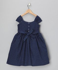 This snazzy party dress will make any little princess shine! Ties at the waist and buttons down the back make looking prim and proper a breeze, while the precious polka dots add extra-special flair.