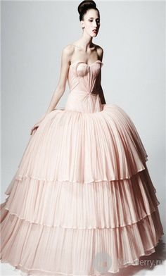 OMG I love love love this one! I love that it is pink and the ruffles and the layers and the corseted bodice! OMG!! (zac posen azalea finale gown)