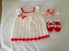 Easy baby Sun Dress pattern by Carol Garcia.  Try using I Love This Yarn in Kaleidoscope.