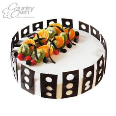 Fresh Cream #Cake with choco chips and fresh #fruit toppings.