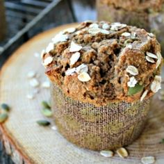 A healthy pumpkin muffin studded with apples, pumpkin seeds, and autumn spices.