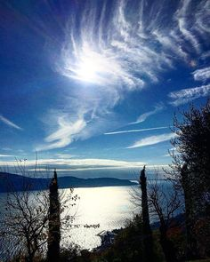 Reposting @michv95: Memory of the lake.  #lake #italy #nature #memory #colours #blue #sun #clouds #reflection #trees #leaves #horizon #amazing #wonderful #love #relax #postcard #skyporn #cloudporn #autumn #november #beautiful #italia #light #photography #natura #sunshine #top #thoughts #you