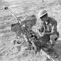 A soldier examines a captured German 28mm sPzB 41 anti-tank gun Sicily 21 July 1943.