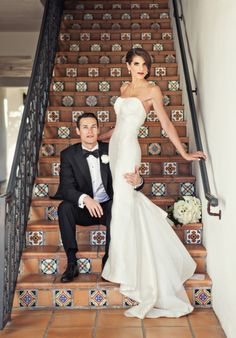 The wedding of Jessica and Troy - picture on Spanish tiled steps. Photo by Joy Marie Studios.