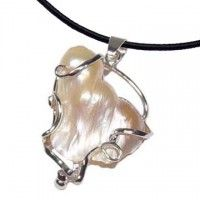 Wow! Stunning and eye catching pearl pendant! I love the detail of the metal entangled with the formation of the pearl.