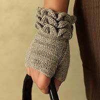 hand-knitted fingerless mittens.  If i ever learn how to knit I'll have to make some of these