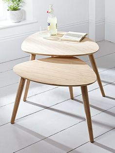 Our stunning Aalto range combines Scandinavian design, sustainability and quality for a timeless and stylish collection that is suitable for all spaces in your home. Our pair of nesting tables have been crafted from durable carbonised bamboo with three tapered legs and a mid-century style shaped top. Nest together for a decorative display, or use separately as a handy side table or even as a simple alternative to a bedside table.